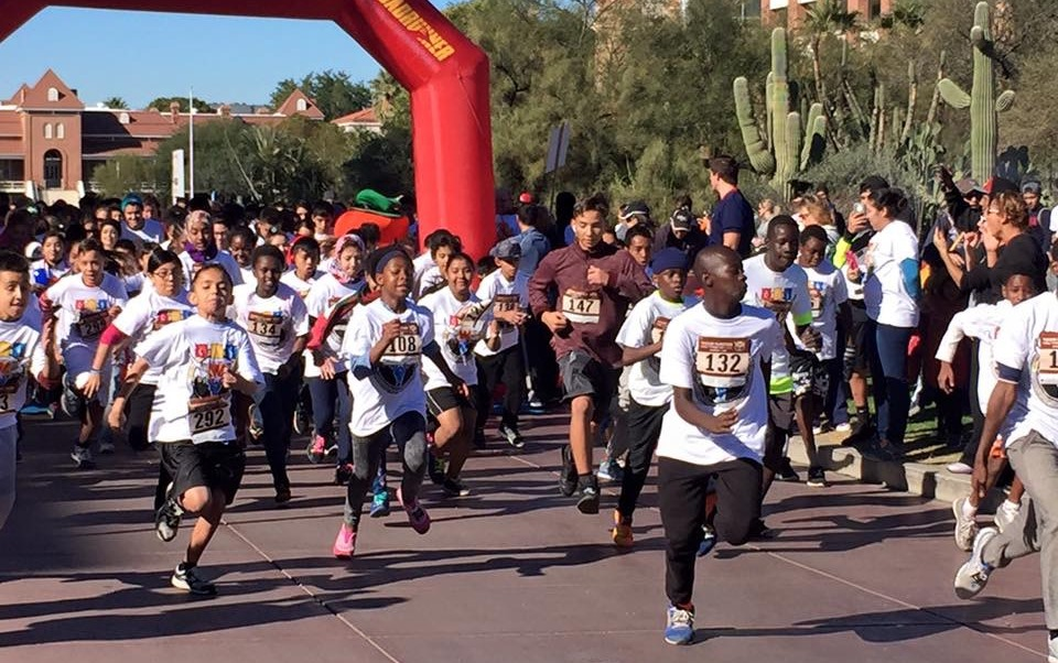 children and families start the race at the Fifth Annual Tucson Marathon Family Fitness Festival on December 3, 2016