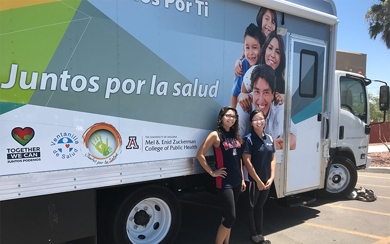 """program, """"Juntos Por la Salud"""" (Together For Health) Primary Prevention Mobile Unit, offers free health screening services and travels to communities in Tucson with the help of students. From left, Camille Gonzalez, a graduate student from the UA Mel and Enid Zuckerman College of Public Health and Yvonne Mei, an undergraduate student in the nutritional sciences program at the UA College of Agriculture and Life Sciences."""